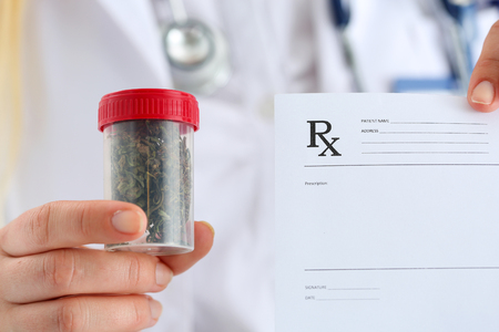 prescribe: Female medicine doctor hand hold and offer to patient medical marijuana in jar. Cannabis recipe for personal use, legal light drugs prescribe, alternative remedy or medication, folk medicine concept Stock Photo
