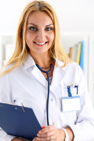 Beautiful smiling female doctor hold and hug clipboard pad portrait. Physical, exam, er, disease prevention, ward round, patient visit check, 911, prescribe remedy, healthy lifestyle concept