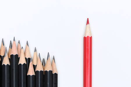 dissent: Red pencil standing out from crowd of plenty identical black fellows on white background. Leadership, uniqueness, independence, initiative, strategy, dissent, think different, business success concept