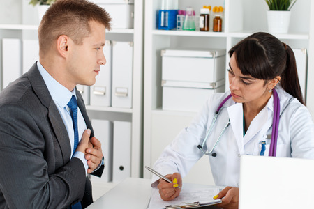 myocardium: Concerned beautiful female doctor listen carefully businessman patient complaints. Therapeutist prescribe remedy, myocardium therapy, ward round, 911, cardio protection, healthy lifestyle concept