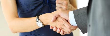 Businessman and woman shake hands as hello in office closeup. Friend welcome, introduction, greet or thanks gesture, product advertisement, partnership approval, arm, strike a bargain on deal concept Stock Photo