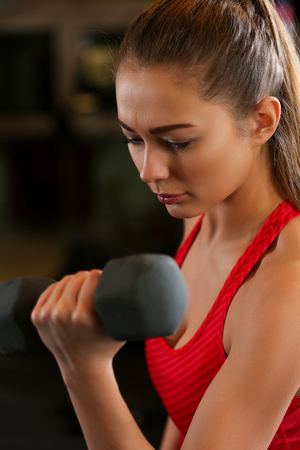 lift hands: Sporty young woman work out biceps. Modern athletic trend, health care, heavy work, calorie burn diet, slim and power people, hobby and leisure activity, action wear shop, gain and pain concept Stock Photo