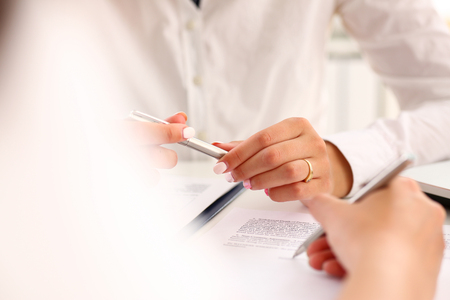 Arm fill and sign important form clipped to pad with silver pen closeup. Make note gesture read pact sale agent bank job loan credit mortgage investment finance chief legal law take part in campaign