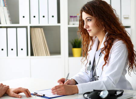 Beautiful smiling female doctor talk with patient about his history list. Physical, exam, er, anamnesis communication, disease prevention, ward round, 911, prescribe remedy, healthy lifestyle concept