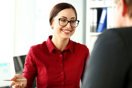 Beautiful smiling clerk wearing glasses with silver pen in arm deliberate on problem at office workplace portrait. Partnership dispute talk client win situation successful visit benefit collaboration Banco de Imagens
