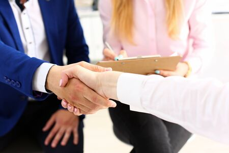 Businessman and woman shake hands as hello in office closeup. Friend welcome, introduction, greet or thanks gesture, product advertisement, summit approval, arm, strike a bargain on deal concept