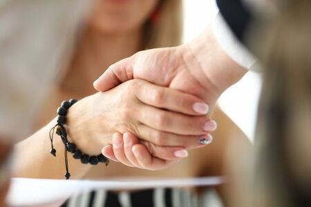 Man and woman shaking hands as symbol for positive prospects or gratitude for support and future opportunities close-up