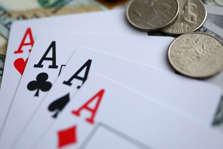 Playing cards lying at money stake with aces combination close-up 写真素材
