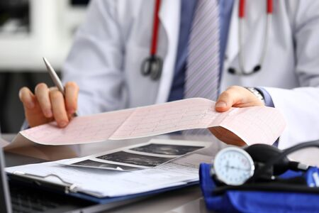 Doctor explains cardiogram data, consultation. Repeated consultation, doctor develops an optimal treatment regimen, explains how to properly control state health. Prevention, treatment heart disease.