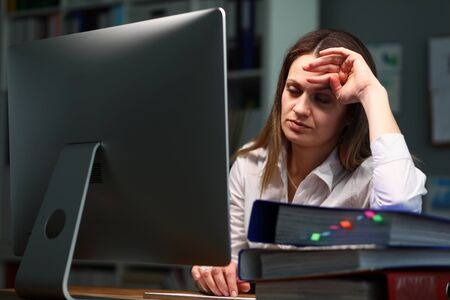 Woman tired checking documents, closed her eyes. Torture to do many things at once at work. Woman closes in herself, nervous breakdown sets in. Use self-control to perform complex task
