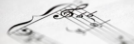Musical notes printed on paper sheet close-up