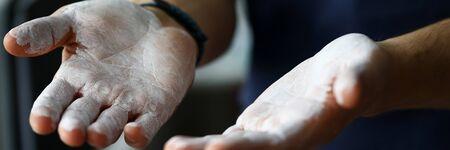 Male hands smeared with magnesium powder ready to workout close-up Zdjęcie Seryjne