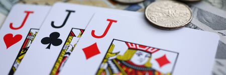 Letterbox view of playing cards lying at money stake with jack combination close-up