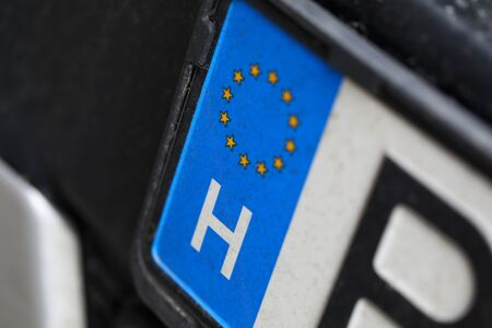 Close-up of car european license plate. Automobile from eu. Macro shot of registration number from european union. Small stars placed in circle. Vehicle and transport concept Stockfoto