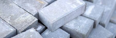 Pile of gray walkway slab lying down outdoor close-up
