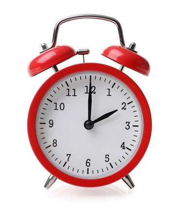 Red alarm clock set at two isolated over white background close-up with clipping path
