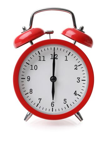 Red alarm clock set at six isolated over white background close-up with clipping path Stock Photo
