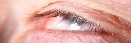 Male eyelashes extreme close-up with eyes rolled up