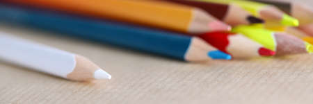 Close-up of bright pencils. White green orange yellow and red colours. Macro shot of supplies for company work. Thing for drawing or writing. Office stationery concept