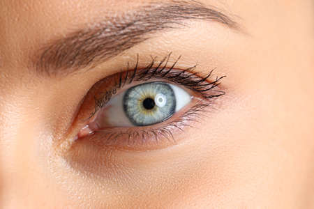 Amazing female blue and green colored eye close-up