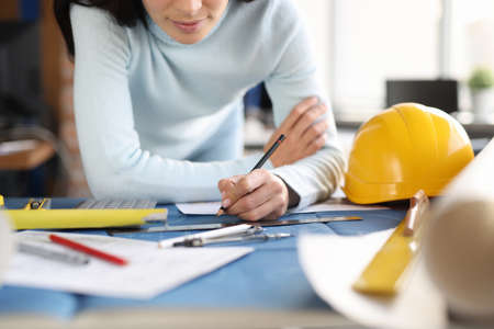 Designer builder hands draw drawing on table. Development in the field of construction concept
