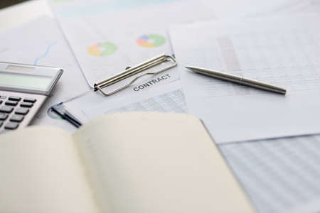 On table is contract pen and documents. Small and medium business development concept