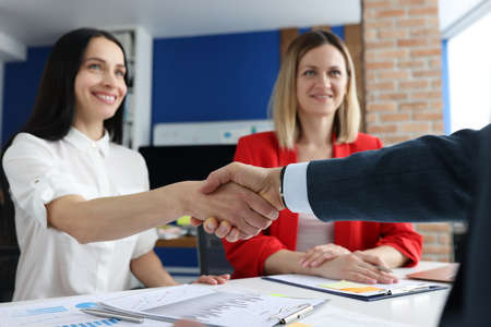 Closeup of successful business people handshake in office. Business negotiations concept