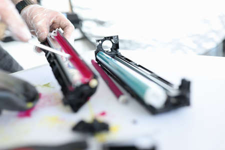 Wizard makes ink replacements in printer cartridge. Printer service concept