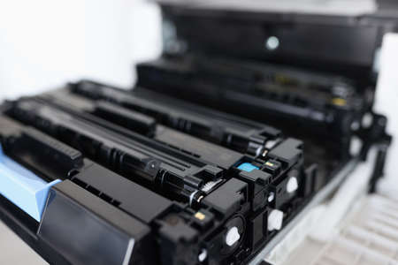 Toner cartridges for laser color printers and mfp, Maintenance and replacement of cartridges in printers concept