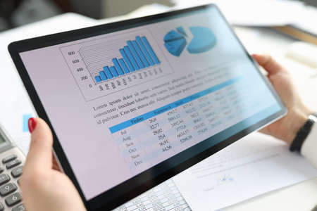 Female hands holding digital tablet with graphs and charts concept Stock fotó