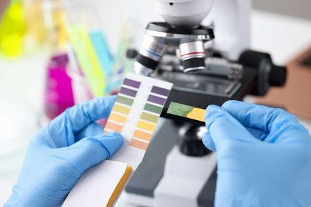 Scientist chemist holding ph test in his hands closeup Foto de archivo
