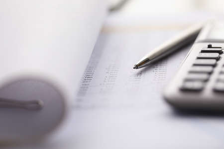 Close-up of accounting tools lying on statement