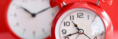 Two red alarm clocks with different times Stock fotó