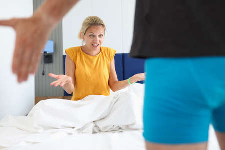Surprised woman looks at man in shorts Stock Photo