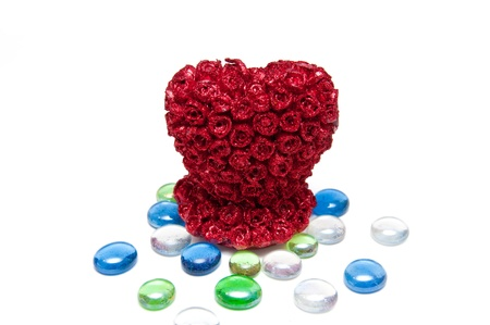 Beautiful red heart candle and multicolors gemestones photo