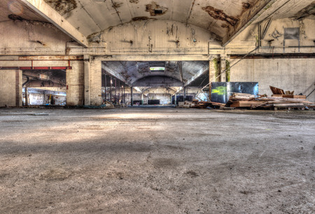 HDR Image of a disused huge moldy vandalized warehouse photo