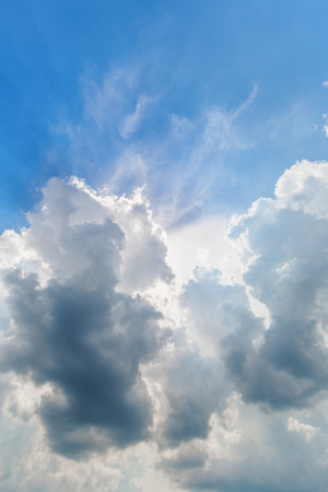 blue cloudy sky: Background of blue cloudy sky with sun rays