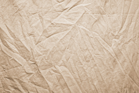 inaccurate: Background of crumpled dense fabric colored in beige tones Stock Photo