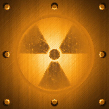 radiation sign: Radiation sign on metal surface effect background in orange tones Stock Photo