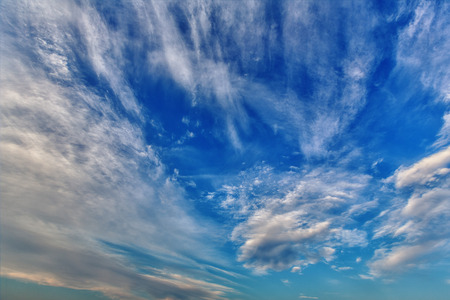fleecy: Background of blue sky with fleecy clouds