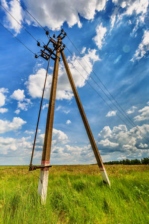 Powerline against a background of the cloudy sky 版權商用圖片
