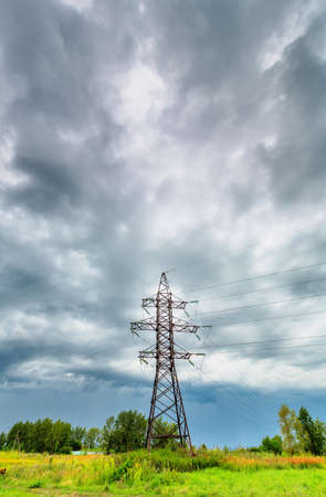 High voltage line on a background of cloudy sky