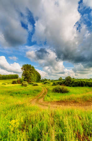 Blue sky with clouds over the hills. Rural landscape
