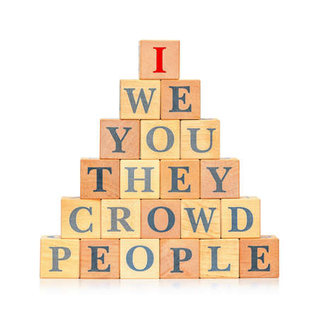Pyramid of wooden blocks with words. Concept of individuality and egoism
