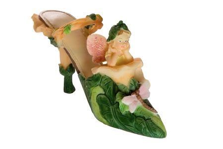 Thumbelina-shoe on a white background (miniatures) Series photo