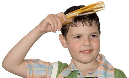 The boy hair combs (hygiene) photo