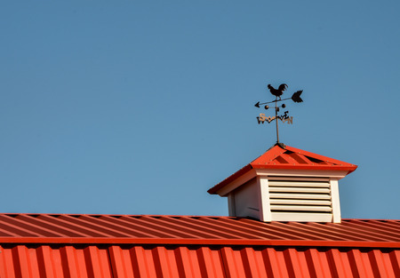 Red barn with rooster weathervane