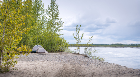 Two tents beside a river in Alaska