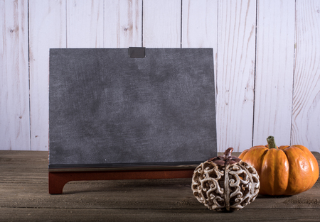 Blank Chalkboard with pumpkins against white wooden background Zdjęcie Seryjne