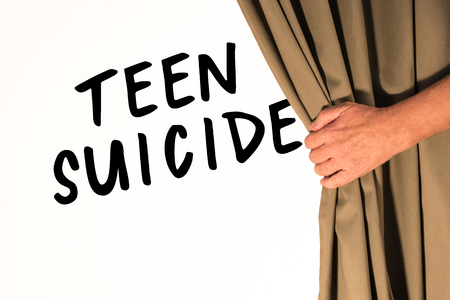 The words Teen Suicide being revealed from behind a curtain Zdjęcie Seryjne